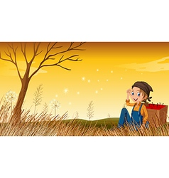 A young boy above hill resting vector