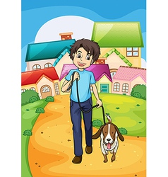 A happy young boy walking with his pet vector image
