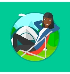 Woman sitting in folding chair in the camp vector image