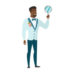 African-american groom holding hand mirror vector