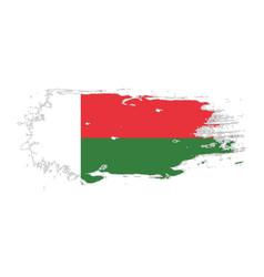 grunge brush stroke with madagascar national flag vector image
