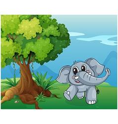 An elephant beside the tree vector