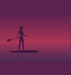 girl on a sup board at sunset vector image