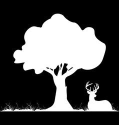 Silhouette of deer lying under tree on the grass vector image