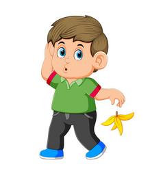 a man toss the banana peel he just ate earlier vector image