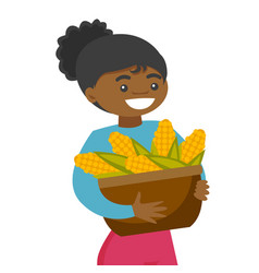 A black happy woman with a basket of corncobs vector