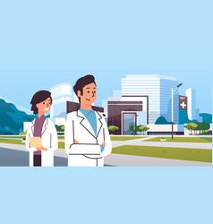 couple man woman doctors in uniform standing vector image