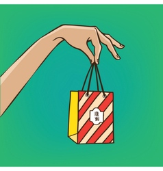 Outstretched hand with gift bag vector