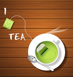 a cup of hot green tea and tea bag with steam vector image vector image