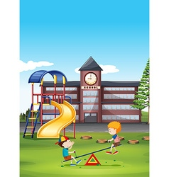Two boys playing seesaw at school vector image