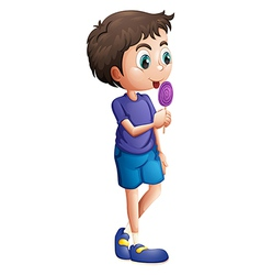 a young boy eating lollipop vector image