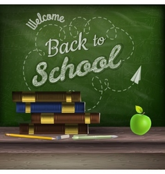 School books and apple against blackboard EPS 10 vector image