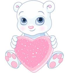 teddy bear holds heart vector image vector image