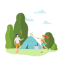 guy and a girl play badminton at a campsite vector image