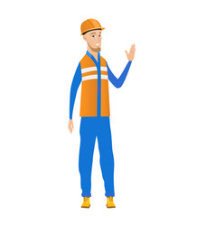 Young caucasian builder waving his hand vector