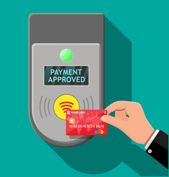 Terminal and bank card in hand vector