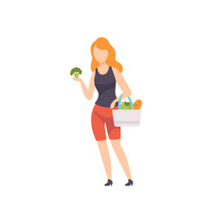 young woman standing with bag full of vegetables vector image