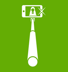 selfie stick with mobile phone icon green vector image