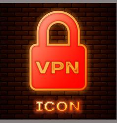 Glowing neon lock vpn icon isolated on brick wall vector