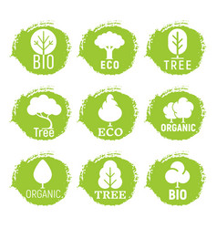 Eco friendly organic tree logos on green grunge vector