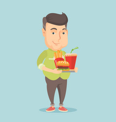 man holding tray full of fast food vector image
