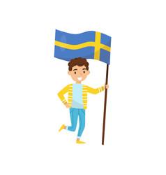 Boy holding national flag of sweden design vector