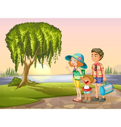 man woman and kid standing around tree vector image