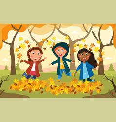 Three happy kids plying amongst autumn leaves vector