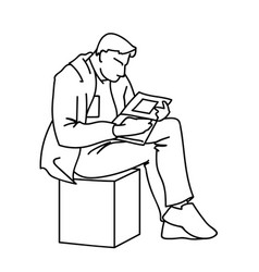an adult man is reading a book sitting on a cube vector image