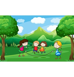 Four kids playing outdoor near the trees vector