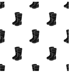 Rubber boots icon in black style isolated on white vector