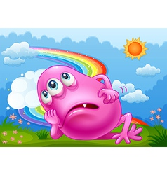 A tired pink monster at the hilltop with a rainbow vector