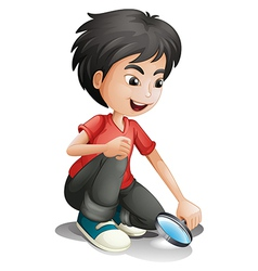 A boy and a magnifier vector image vector image
