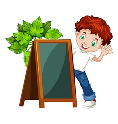 Little boy behind the chalkboard vector image