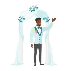 happy groom standing under the wedding arch vector image vector image