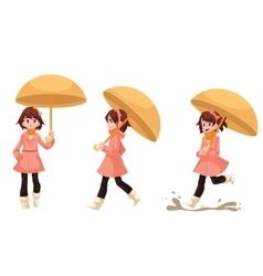 Little girl in a raincoat with umbrella enjoying vector image