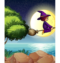 A witch flying with a broom in the middle of the vector image
