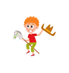Boy riding stick horse and waving cowboy hat vector