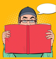 Pop art surprised man holding book vector