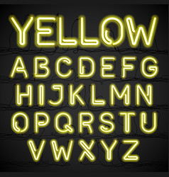 yellow neon light alphabet with cable vector image vector image