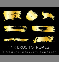set of golden paint strokes to make a background vector image