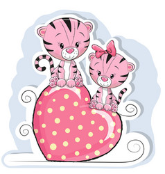 two cute tigers is sitting on a heart vector image