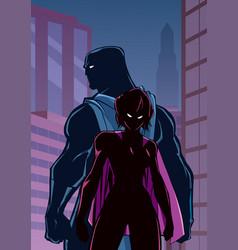 Superhero couple in city silhouette vector