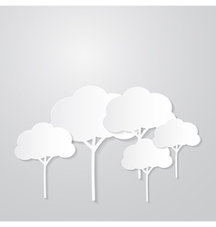White trees cut from paper on grey background vector