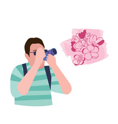 a man taking pictures cherry blossom with photo vector image