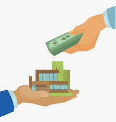 real estate purchase with businessman hand holding vector image