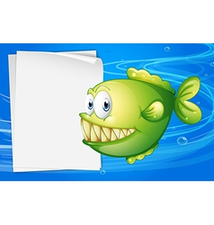 A green piranha beside an empty signboard vector