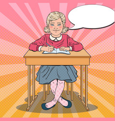 Pop art schoolgirl sitting at school desk vector