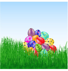 bunch of easter eggs on the grass vector image