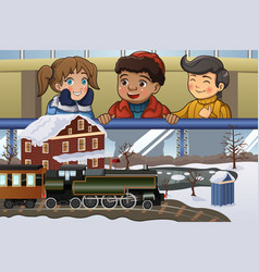 Kids looking at miniature train vector